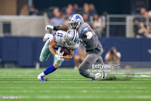 Dallas Cowboys wide receiver Cole Beasley is tackled by Detroit Lions linebacker Jarrad Davis during the game between the Detroit Lions and Dallas...