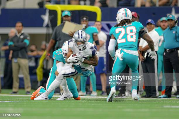 Dallas Cowboys Wide Receiver Devin Smith makes a catch with Miami Dolphins Cornerback Eric Rowe defending during the game between the Miami Dolphins...