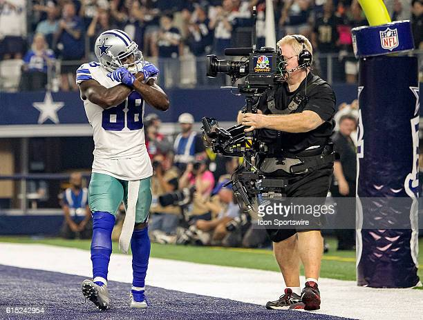 Dallas Cowboys Wide Receiver Dez Bryant [11280] shows his signature X to the TV camera after scoring a touchdown during the NFL game between the...
