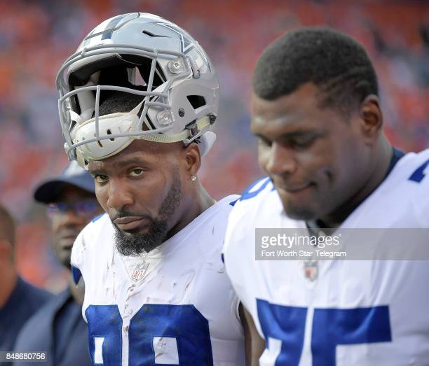 Dallas Cowboys wide receiver Dez Bryant and offensive tackle Byron Bell head to the lockers at halftime as the Denver Broncos beat the Dallas Cowboys...