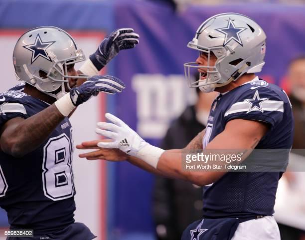 Dallas Cowboys wide receiver Dez Bryant and quarterback Dak Prescott celebrate Bryant's second quarter touchdown against the New York Giants on...