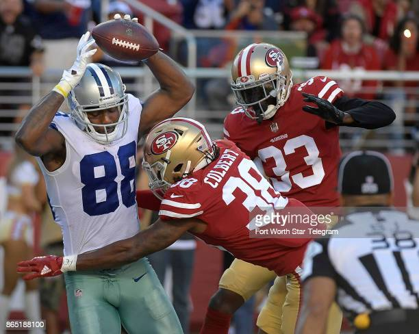 Dallas Cowboys wide receiver Dez Bryant comes down with a fourth quarter touchdown catch in double coverage by San Francisco 49ers defensive back...