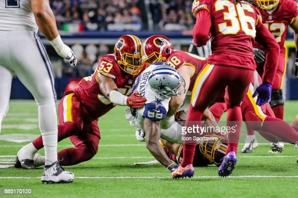 Dallas Cowboys wide receiver Dez Bryant gets tackled by Washington Redskins cornerback Kendall Fuller linebacker Zach Brown and defensive tackle Matt...