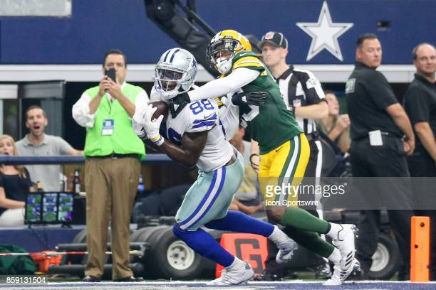 Dallas Cowboys wide receiver Dez Bryant makes a touchdown reception with Green Bay Packers cornerback Damarious Randall defending during the football...
