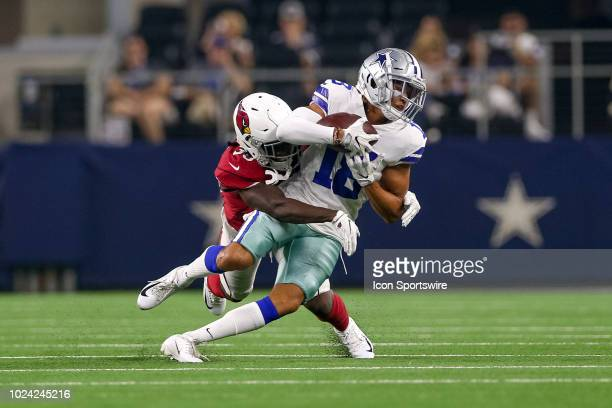 Dallas Cowboys wide receiver Dres Anderson makes a catch and is tackled by Arizona Cardinals cornerback Deatrick Nichols during the preseason...