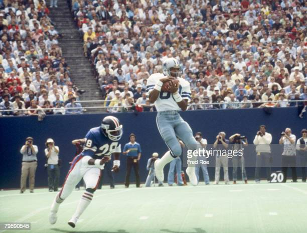 Dallas Cowboys wide receiver Drew Pearson making a difficult catch over a New York Giants defender in the Cowboys 243 victory over the Giants on...