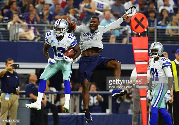 Dallas Cowboys wide receiver Lucky Whitehead goes up to celebrate a TD catch with wide receiver Dez Bryant during a NFL preseason season game between...