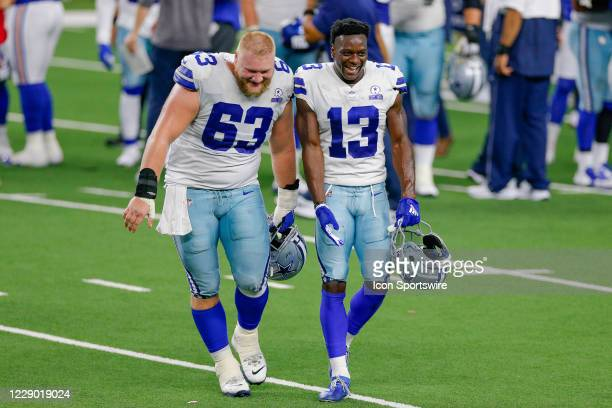 Dallas Cowboys Wide Receiver Michael Gallup and Center Tyler Biadasz walk off the field following their win of the NFL game between the New York...