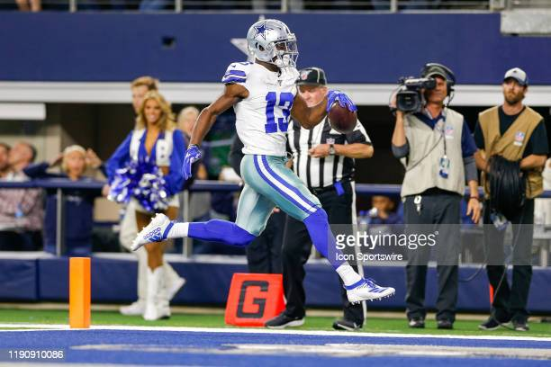Dallas Cowboys Wide Receiver Michael Gallup cartwheels after the catch and scores a long touchdown during the NFC East game between the Dallas...