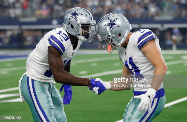 Dallas Cowboys wide receiver Michael Gallup celebrates his catch with wide receiver Cole Beasley against the Detroit Lions during the first half on...