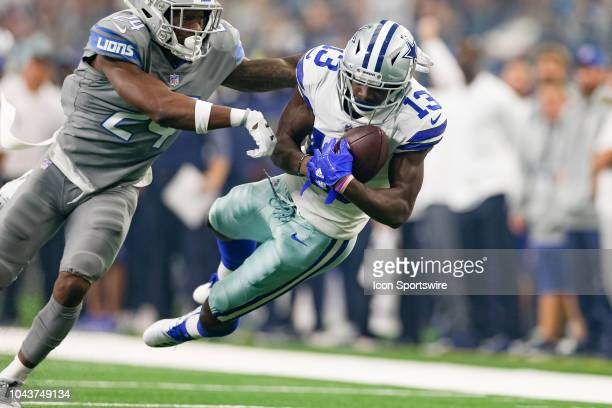 Dallas Cowboys wide receiver Michael Gallup makes a long reception with Detroit Lions defensive back Nevin Lawson defending during the game between...
