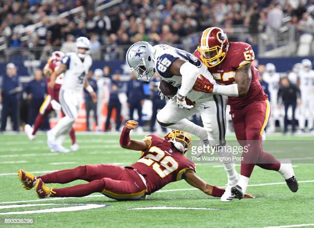 Dallas Cowboys wide receiver Noah Brown is tackled by Washington Redskins cornerback Kendall Fuller and Washington Redskins inside linebacker Zach...