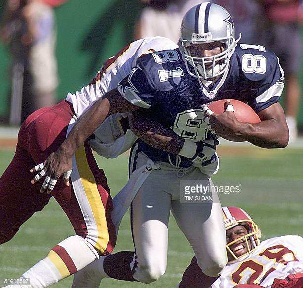 Dallas Cowboys wide receiver Raghib Ismail rushes through two Redskin defenders at Jack Kent Cooke Stadium 12 September Landover Maryland Ismail...