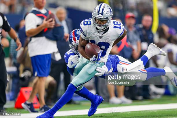 Dallas Cowboys Wide Receiver Randall Cobb breaks through a tackle attempt by New York Giants Linebacker Alec Ogletree during the game between the New...