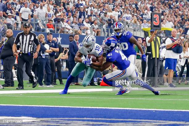 Dallas Cowboys Wide Receiver Randall Cobb drabs New York Giants Safety Antoine Bethea to make a first down during the game between the New York...