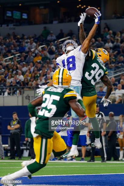 Dallas Cowboys wide receiver Randall Cobb leaps but cannot come down with the catch during the game between the Green Bay Packers and Dallas Cowboys...