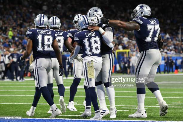 Dallas Cowboys wide receiver Randall Cobb receives congratulations from his teammate after scoring a touchdown during a regular season game between...