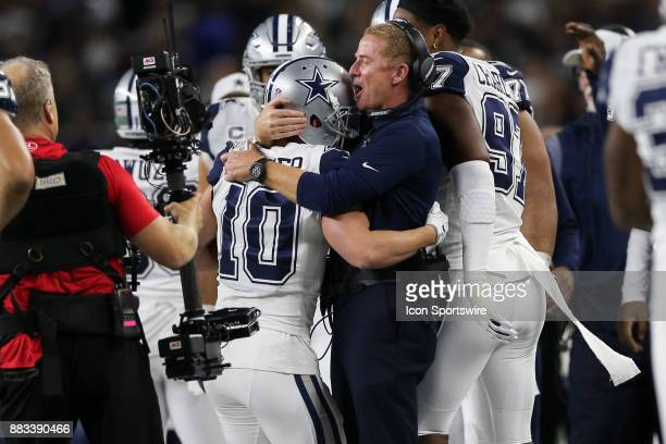 Dallas Cowboys wide receiver Ryan Switzer is hugged by head coach Jason Garrett after running back a punt for a touchdown during the Thursday Night...