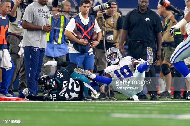 Dallas Cowboys wide receiver Tavon Austin is tackled by Jacksonville Jaguars strong safety Barry Church during the game between the Jacksonville...