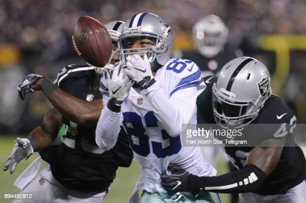 Dallas Cowboys wide receiver Terrance Williams cannot hang on to a pass as Oakland Raiders strong safety Karl Joseph hits him in the third quarter on...