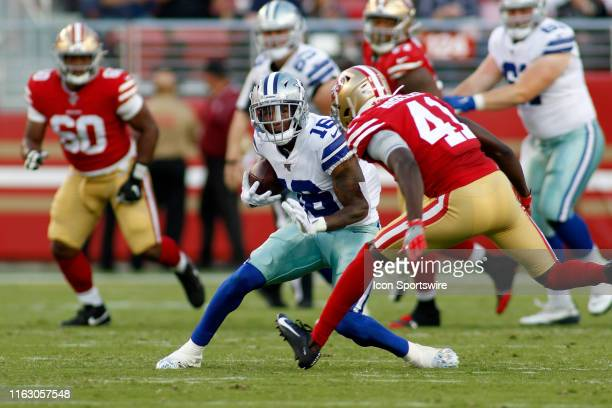 Dallas Cowboys WR Cedrick Wilson tries tp elude San Francisco 49ers CB Emmanuel Moseley in the NFL pre-season game between the Cowboys and 49ers on...