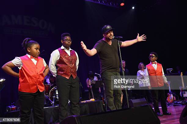 Dallas Davidson introduces the James Brown Academy of Musik Pupils at Georgia on My Mind hosted by the Peach Pickers and Friends a benefit for the...