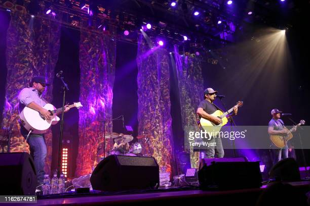 Dallas Davidson Rhett Akins and Ben Hayslip of The Peach Pickers performs onstage during the 6th Annual Georgia On My Mind presented by Gretsch at...