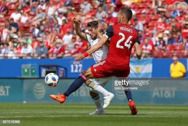 Dallas defender Matt Hedges and Portland Timbers midfielder Sebastian Blanco fight for the ball during the soccer match between the Portland Timbers...