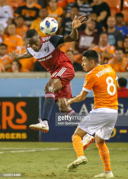 Dallas defender Maynor Figueroa heads the ball away from Houston Dynamo midfielder Memo Rodriguez during the soccer match between FC Dallas and...