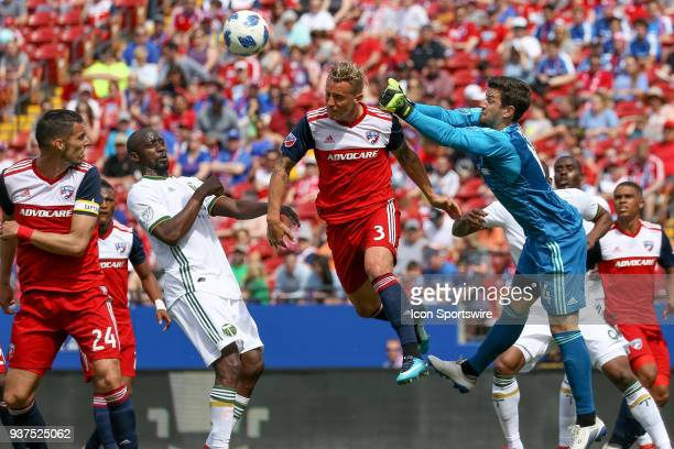 Dallas defender Reto Ziegler and goalie Jimmy Maurer play the ball during the soccer match between the Portland Timbers and FC Dallas on March 24...