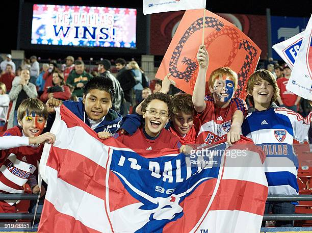 Dallas fans celebrate Dallas's 21 defeat of the Colorado Rapids at Pizza Hut Park on October 17 2009 in Frisco Texas