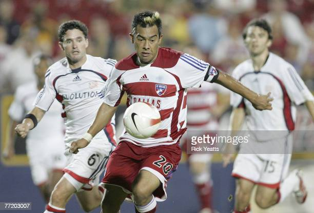 Dallas forward Carlos Ruiz receives a pass in front of NE Revolution defender Jay Heaps during the 2007 Lamar Hunt US Open Cup Final on October 3...