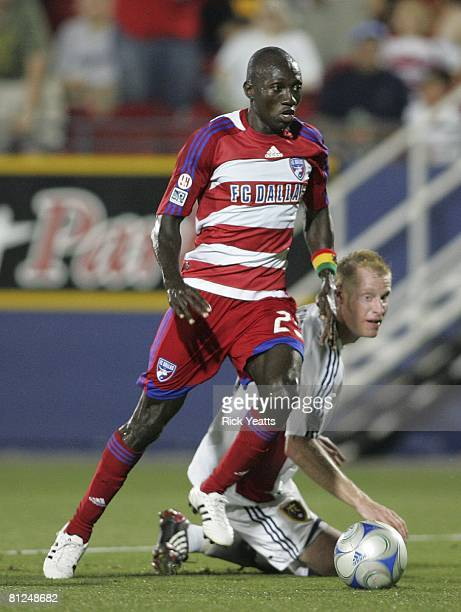 Dallas forward Dominic Oduro dribbles the ball around Real Salt Lake defender Nat Borchers on May 24 2008 at Pizza Hut Park in Frisco Texas Dallas...