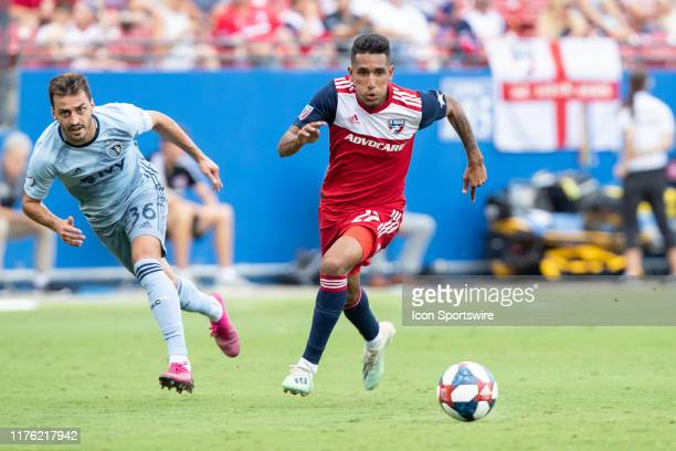 Dallas forward Jesus Ferreira dribbles up field past Sporting Kansas City defender Luis Martins during the MLS soccer game between FC Dallas and...