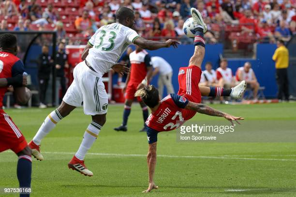 Dallas forward Maximiliano Urruti attempts a bicycle kick past Portland Timbers defender Larrys Mabiala during the soccer match between the Portland...