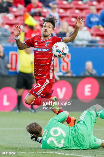 Dallas forward Maximiliano Urruti is called offsides while being challenged by Sporting Kansas City goalkeeper Tim Melia during the MLS match between...