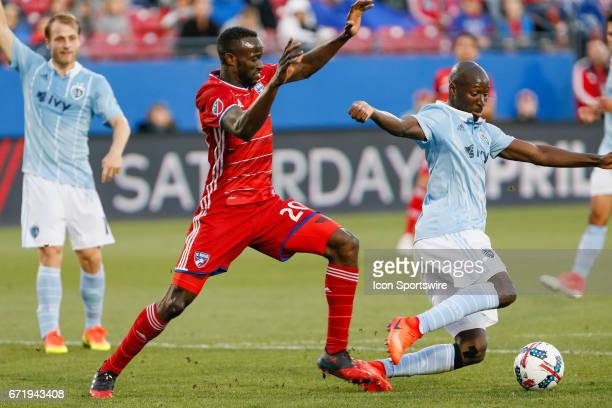 Dallas forward Roland Lamah and Sporting Kansas City defender Ike Opara go for a loose ball during the MLS match between Sporting KC and FC Dallas on...