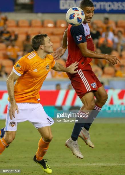 Dallas forward Tesho Akindele heads the ball away from Houston Dynamo forward Andrew Wenger during the soccer match between FC Dallas and Houston...