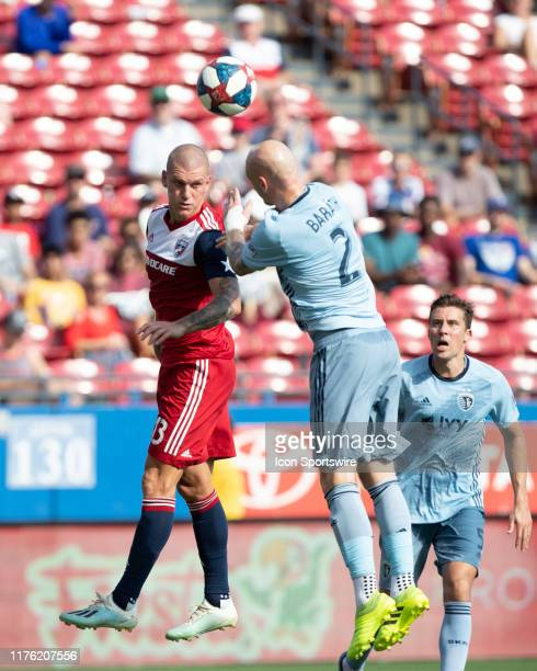 Dallas forward Zdenek Ondrasek and Sporting Kansas City defender Botond Barath go up for a header during the MLS soccer game between FC Dallas and...