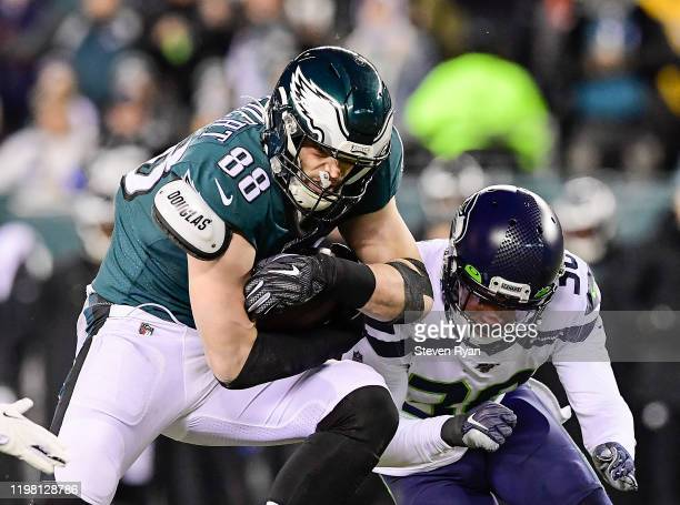 Dallas Goedert of the Philadelphia Eagles carries the ball against Bradley McDougald of the Seattle Seahawks in the NFC Wild Card Playoff game at...