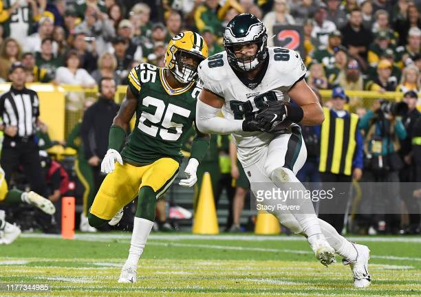 Dallas Goedert of the Philadelphia Eagles catches a touchdown in the second quarter over Will Redmond of the Green Bay Packers during the game at...