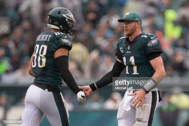 Dallas Goedert of the Philadelphia Eagles celebrates with Carson Wentz against the Indianapolis Colts at Lincoln Financial Field on September 23 2018...