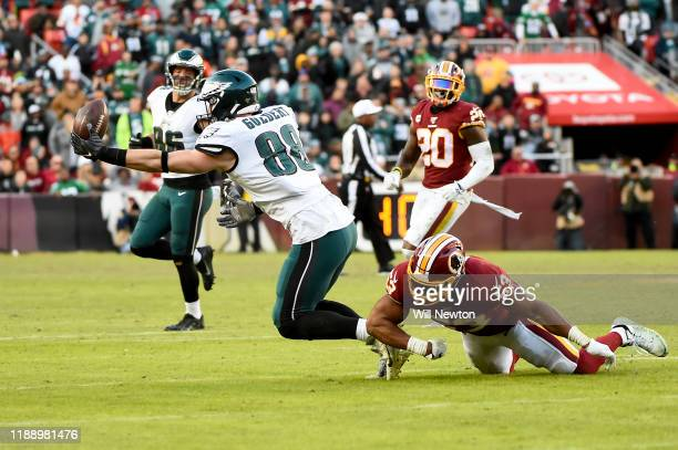 Dallas Goedert of the Philadelphia Eagles makes a catch in front of Jon Bostic of the Washington Redskins during the second half at FedExField on...
