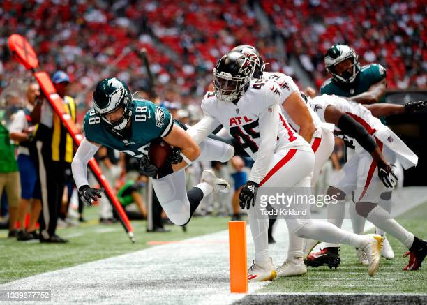 Dallas Goedert of the Philadelphia Eagles reaches for extra yardage after a reception during the second quarter against the Atlanta Falcons at...
