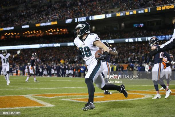 Dallas Goedert of the Philadelphia Eagles scores a touchdown against the Chicago Bears in the third quarter of the NFC Wild Card Playoff game at...