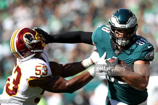 PHILADELPHIA PENNSYLVANIA SEPTEMBER 08 Dallas Goedert of the Philadelphia Eagles stiff arms Jon Bostic of the Washington Redskins after making a...