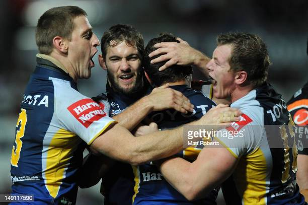 Dallas Johnson of the Cowboys celebrates with teammates during the round 20 NRL match between the North Queensland Cowboys and the Wests Tigers at...