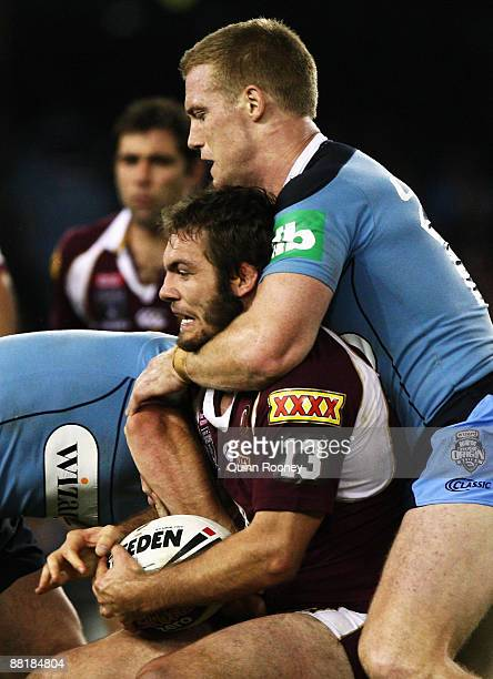 Dallas Johnson of the Maroons is tackled is tackled high by Ben Creagh of the Blues during game one of the ARL State of Origin series between the...