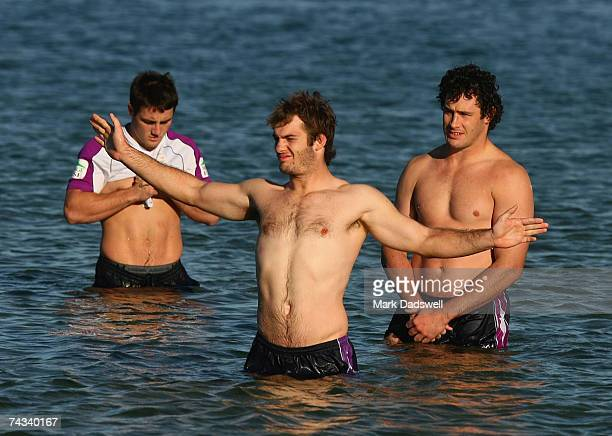 Dallas Johnson of the Storm stretches his arms while in the cold water during the Melbourne Storm Recovery session at the St Kilda Sea Baths May 27...