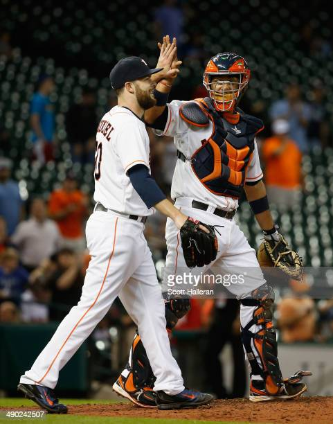 Dallas Keuchel and Carlos Corporan of the Houston Astros celebrate on the mound after Keuchel pitched a shutout in an 80 victory against the Texas...
